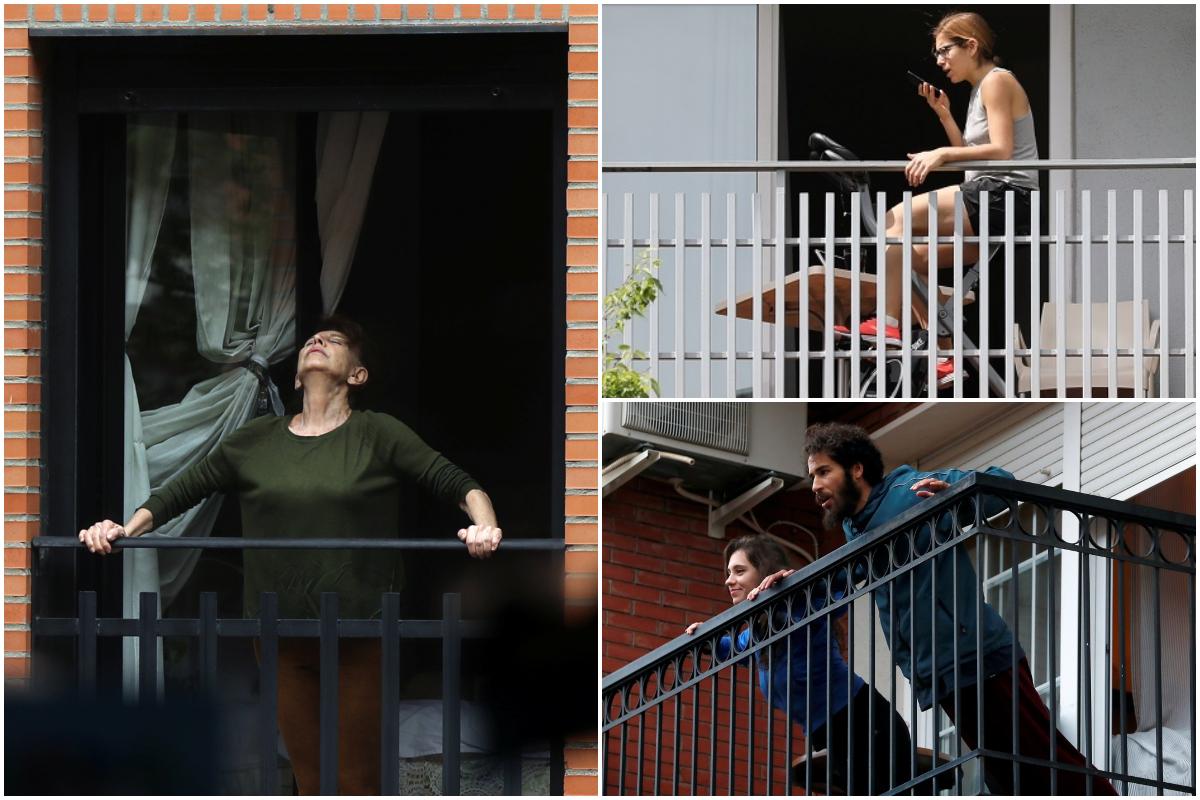 Varias personas hacen ejercicio en su balcón durante la cuarentena por coronavirus en España. / REUTERS