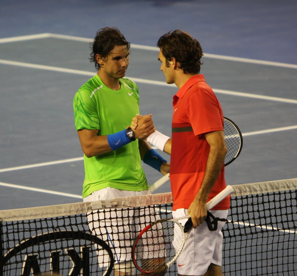 Rafa Nadal y Roger Federer en el Open de Australia de 2012. Brett Marlow / Flickr, CC BY-ND
