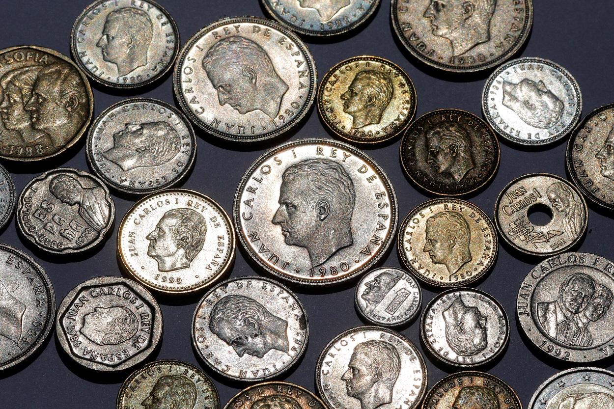 Monedas de las antiguas pesetas, con la efigie de Juan Carlos I. REUTERS/Jon Nazca