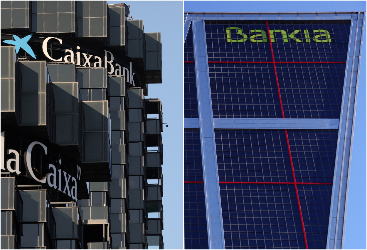 Las sedes de Caixabank y de Bankia en Madrid. REUTERS