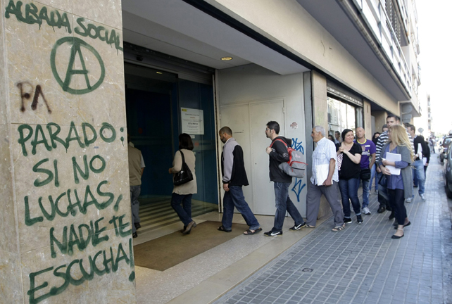 People enter an unemployment registry office in Mataro near Barcelona