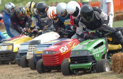 Lawnmower races at Miller Airport in  The drivers run to the lawnmowers---Jim Mikula from sparta  #14 far right in the B/P HEAT